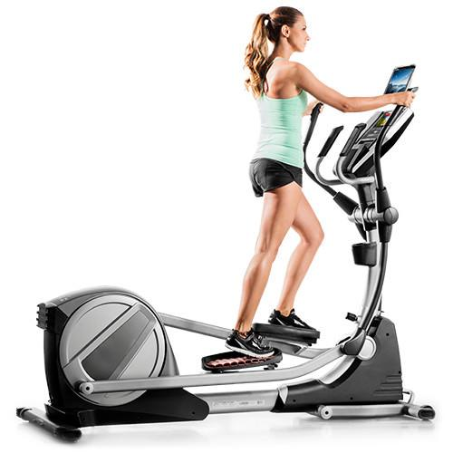 A woman working out using Proform Smartstrider 895 CSE